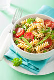 Vegetarian pasta fusilli with tomato peas herbs Royalty Free Stock Photography