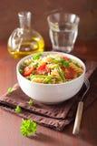 Vegetarian pasta fusilli with tomato peas herbs Stock Image