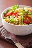Vegetarian pasta fusilli with tomato peas herbs Stock Photos