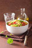 Vegetarian pasta fusilli with tomato peas herbs Royalty Free Stock Images