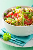 Vegetarian pasta fusilli with tomato peas herbs Stock Photography