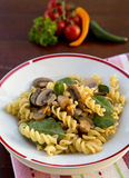 Vegetarian pasta. Healthy vegetarian pasta with rice cream, mushrooms, nuts and baby spinach Stock Photography