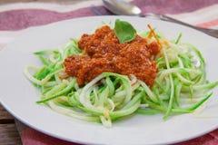 Italian pasta vegan. Vegetarian pasta made with zucchini spaghetti and tomato pesto Royalty Free Stock Image