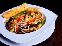 Vegetarian pasta in olive oil Stock Images