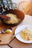 Vegetarian pasta with sun-dried tomatoes and cheese. Home cooking. Dinner at home. Macaroni and a fork on a white plate. Cooking stock image