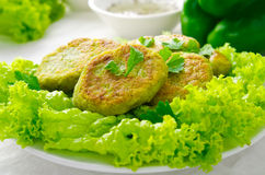 Vegetarian patties of broccoli with pepper, greens and herbs, on white background Stock Photo