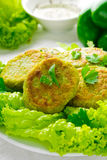 Vegetarian patties of broccoli with pepper, greens and herbs, on white background Royalty Free Stock Photo