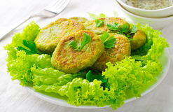 Vegetarian patties of broccoli with pepper, greens and herbs, on white background Stock Image