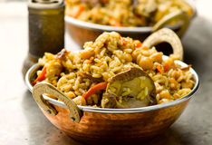 Vegetarian pilaf with chick-pea and mushrooms Royalty Free Stock Photos
