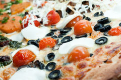 Vegetarian pizza. Pizza with black olives tomato and goat cheese Stock Image