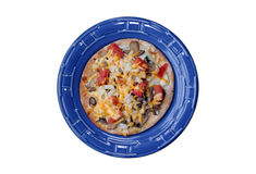 Vegetarian Pizza on Blue Plate. A vertical view of a healthy vegetarian pizza served on a blue plastic plate Royalty Free Stock Photography
