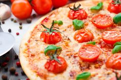 Vegetarian pizza with cherry tomatoes Stock Photography