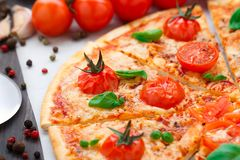 Vegetarian pizza with cherry tomatoes Royalty Free Stock Image