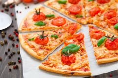 Vegetarian pizza with cherry tomatoes Stock Images