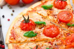 Vegetarian pizza with cherry tomatoes Royalty Free Stock Photo