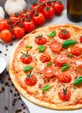 Vegetarian pizza with cherry tomatoes Stock Photos