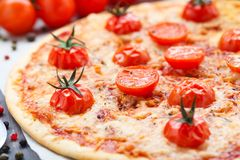 Vegetarian pizza with cherry tomatoes Royalty Free Stock Photos