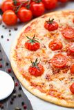 Vegetarian pizza with cherry tomatoes Royalty Free Stock Images