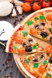 Vegetarian pizza. With cherry tomatoes mushroom and olives Royalty Free Stock Photo