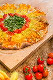 Vegetarian pizza. With pumpkin flowers, tomatoes and peas Royalty Free Stock Image