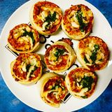 Vegetarian Pizza rolls. With cheese tomato sauce and spinach Royalty Free Stock Image