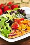 Vegetarian pizza with salad Stock Photos