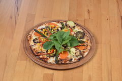 Vegetarian Pizza. Served on wooden plate Stock Photo