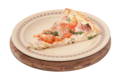 VEGETARIAN PIZZA SLICE PLATE ISOLATED RUCOLA TOMATO Royalty Free Stock Photography