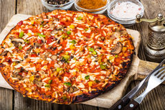 Vegetarian pizza with tomatoes and mushrooms Royalty Free Stock Photo