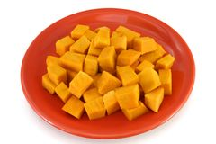 Vegetarian plate - pumpkin bites. Low calories vegetarian food on a red plate royalty free stock photo