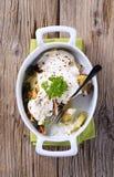 Vegetarian potato dish on wooden background royalty free stock photo