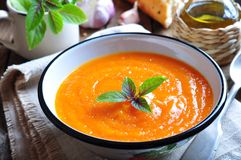 Vegetarian pumpkin soup with garlic, basil and olive oil Royalty Free Stock Images