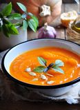Vegetarian pumpkin soup with garlic, basil and olive oil Stock Photos
