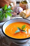 Vegetarian pumpkin soup with garlic, basil and olive oil Royalty Free Stock Photo