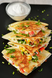 Vegetarian quesadilla. With sour cream. Selective focus on the front wedge stock images