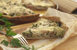 Vegetarian quiche with broccoli. Vegetarian quiche with broccoli, eggs and milk products: cheese and cream cheese . One piece served Royalty Free Stock Images