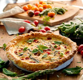 Vegetarian quiche with cherry tomatoes and green asparagus Royalty Free Stock Photo