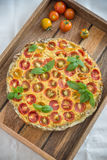 Vegetarian Quiche with cherry tomatoes Royalty Free Stock Image