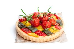 Vegetarian quiche with colored pepper and cherry tomatoes isola. Ted on white Stock Photo