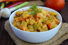 Vegetarian ragout of summer vegetables (zucchini, carrots, tomatoes, spices, garlic, chilli) royalty free stock images