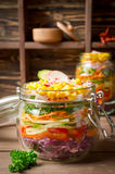 Vegetarian Rainbow salad in a glass jar for summer picnic Royalty Free Stock Images
