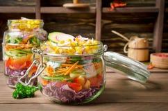 Vegetarian Rainbow salad in a glass jar for summer picnic Stock Photos
