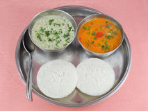 Vegetarian Rice Cakes Idli. Steam-cooked Indian vegetarian rice cake known as idli, which is served with chutney and curry Royalty Free Stock Photos