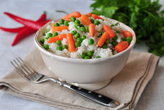 Vegetarian rice with a pea and carrot, vegetables Royalty Free Stock Images