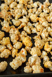 Healthy roasted cauliflower on an oven tray. Vegetarian roasted cauliflower  with turmeric, herbs and garlic Stock Image