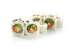 Vegetarian Roll. Vegetarian Maki Sushi -  Roll made of Cucumber, Bell Pepper, Salad Leaf and Carrots inside. Topped with Sesame and Cream Stock Photography
