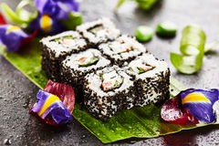Vegetarian Roll. Vegetarian Maki Sushi -  Roll made of Cucumber, Bell Pepper, Salad Leaf and Cream Cheese inside. Sesame outside Stock Photo