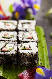 Vegetarian Roll. Vegetarian Maki Sushi -  Roll made of Cucumber, Bell Pepper, Salad Leaf and Cream Cheese inside. Sesame outside Stock Images