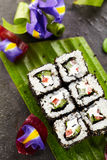 Vegetarian Roll. Vegetarian Maki Sushi -  Roll made of Cucumber, Bell Pepper, Salad Leaf and Cream Cheese inside. Sesame outside Stock Image