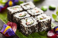 Vegetarian Roll. Vegetarian Maki Sushi -  Roll made of Cucumber, Bell Pepper, Salad Leaf and Cream Cheese inside. Sesame outside Stock Photography